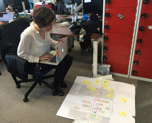 Very often it helps us to create user journey maps and process flows to understand the scope of the service. Here one of our designers, Asli Ozpehlivan, is tweaking a user journey map based on feedback.