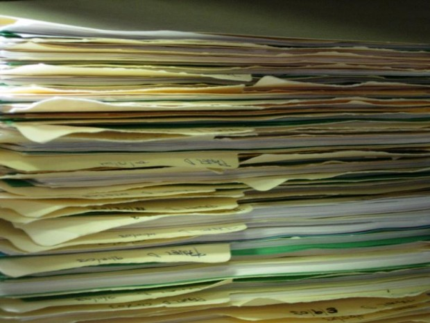 Photo of a pile of paperwork by Tom Ventura from Wikimedia Commons (used under a Creative Commons licence).